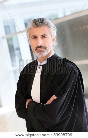 Portrait of lawyer standing in courthouse corrridor