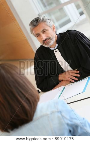 Lawyer meeting client in courthouse office