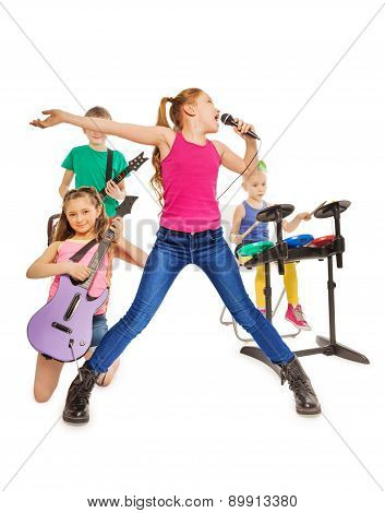 Children play musical instruments and girl sings