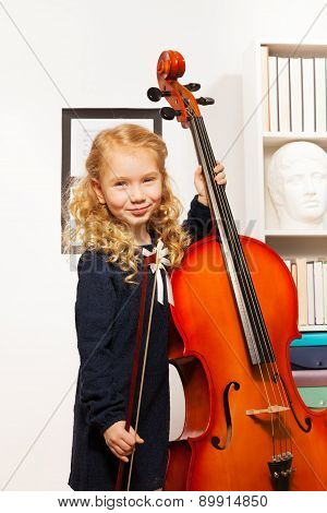 Curly beautiful girl with fiddlestick, violoncello