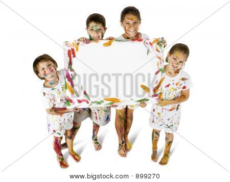 kids covered in paint with blank sign. clipping path. poster