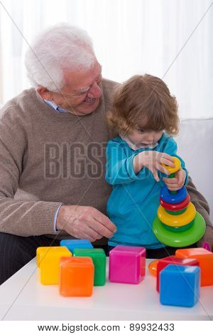 Grandpa And Grandchild Building Tower