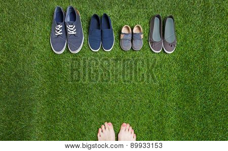 Woman legs and shoes standing  on grass