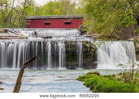Covered Bridge And Waterfall
