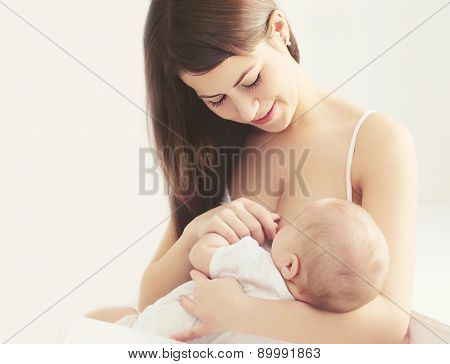Soft Photo Young Mother Feeding Breast Her Baby At Home In White Room