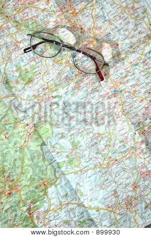 view of large map and reading glasses map reading poster