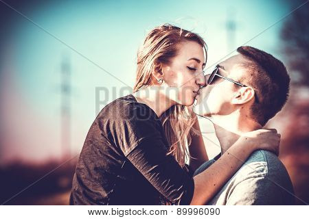 Pretty Couple Kissing Outdoor In The Forest