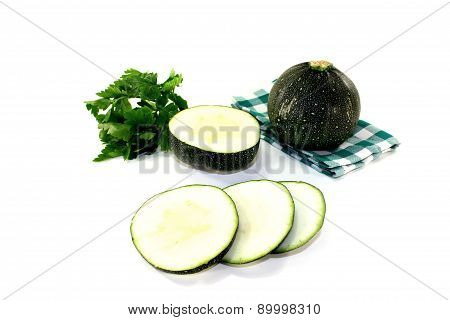 Rotund Raw Zucchini On A Napkin