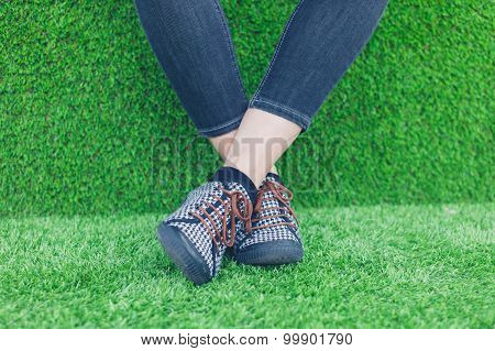 Feet Of Young Woman On Astro Turf