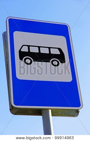 Bus Stop Sign Against Of Blue Sky.