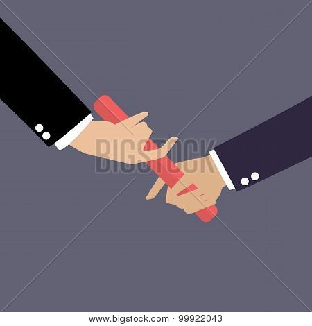 Businessman Hand Passing The Baton In A Relay Race
