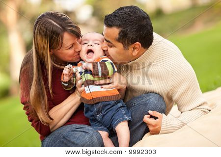 Happy Mixed Race Parents Playing With Their Son