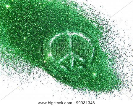 Sign of pacific on green glitter sparkles on white background