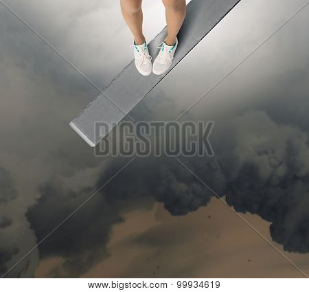 Woman standing on the edge of wooden board