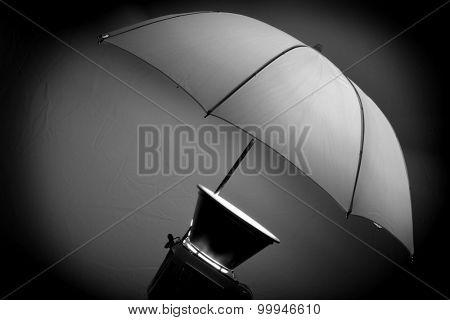 Studio strobe with umbrella for portraits and photographs