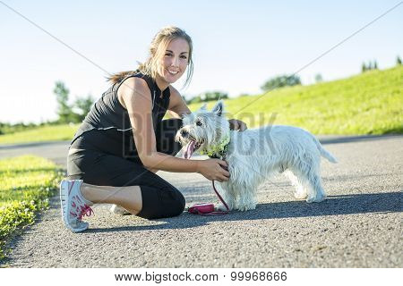 Beautiful young woman jogging with her dog
