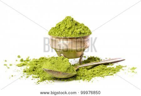 Powder green tea isolated on white background