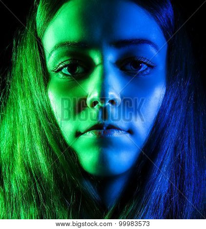 Beautiful Young Woman In Green And Blue Lights