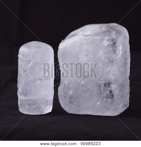 Two Ecologic Deodorant Crystal In Black Background