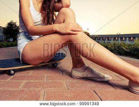 Legs of skateboarder girl