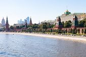Moscow skyline - view of The Kremlin embankment Kremlin buildings walls towers Moscow City in summer afternoon poster