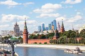 Moscow skyline - view of Kremlin embankments skyscrapers Moscow City district and Moskva River in sunny summer day poster
