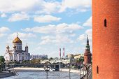 Moscow cityscape - Cathedral of Christ the Saviour and Red wall of Kremlin Tower in Moscow Russia in summer day poster