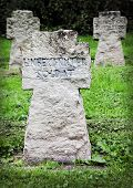 Stone graves in a World War II cemetery close to BГјren in North Rhine-Westphalia, Germany poster