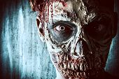 Close-up portrait of a horrible scary zombie man. Horror. Halloween.  poster