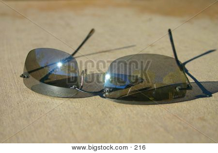 sunglasses reflecting on patio poster