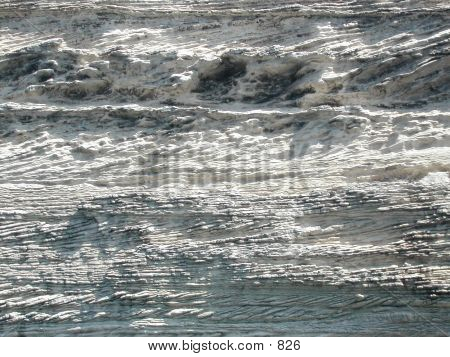 Close up of cliff face. Heavily textured white rock poster