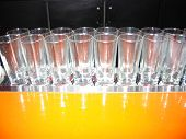 row of bar glasses poster