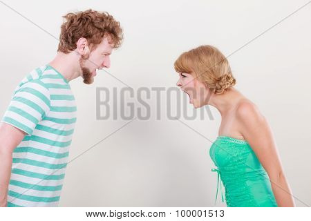 Angry Woman And Man Yelling At Each Other.
