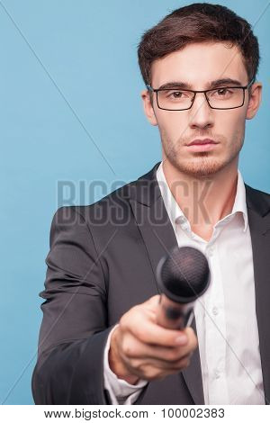 Handsome young male journalist is taking an interview