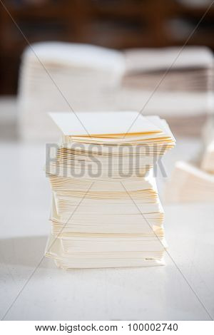 Closeup of stacked white papers on table in factory