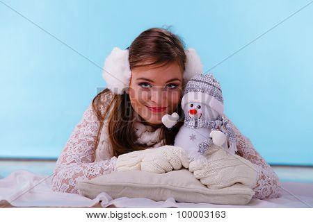 Cute Woman With Little Snowman. Winter Fashion.