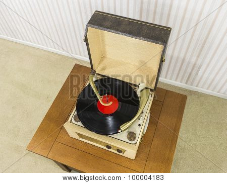 Old record player with vintage vinyl disk.