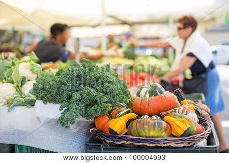 Farmers' food market stall with variety of organic vegetable.