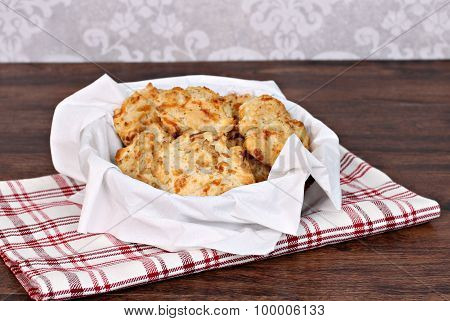 Cheddar, Garlic Biscuits In A Napkin Lined Basket. Selective Focus On Front Biscuit.
