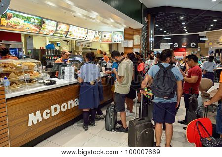 ROME, ITALY - AUGUST 04, 2015: people in McDonald's restaurant. The McDonald's Corporation is the world's largest chain of hamburger fast food restaurants
