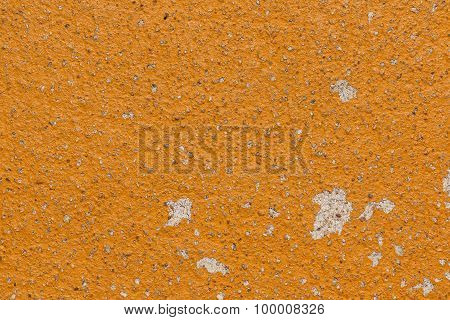 Yellow cracked painted old cement vintage wall background.