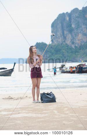 Asian Woman Take Selfie Photo On Beach