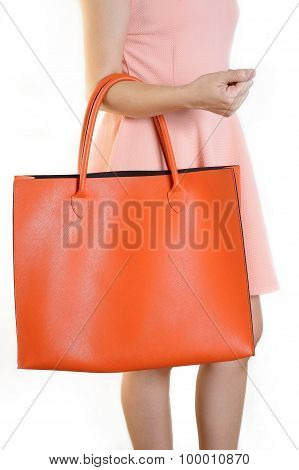 Woman Holding Orange Bags