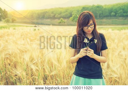 Portrait Of A Beautiful Glasses Woman In Barley Field.