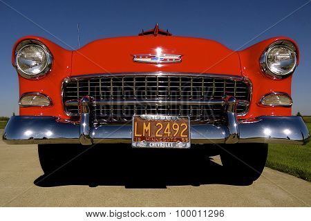 Grill of a red 1955 Chevrolet