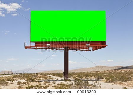 Blank billboard with chroma key green in the middle of the Mojave desert.