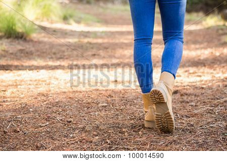Close up view of woman hiking on path in the nature