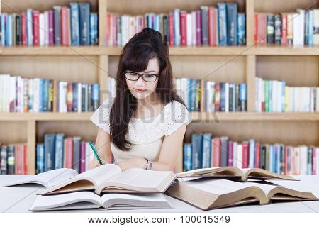 Attactive Learner Doing School Task In Library