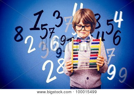 Pupil holding abacus against blue background