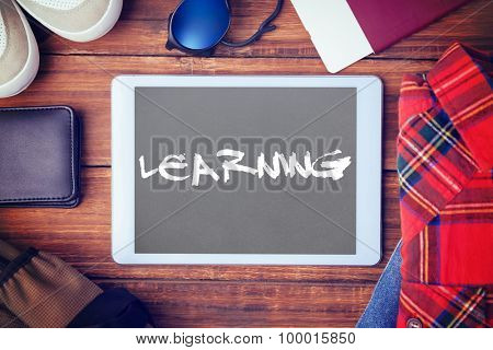 The word learning and differents objects using every days against grey